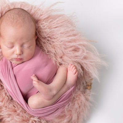 Newborn baby photography photoshoot. Cute baby. Photographer of photo shoot is Cheryl Catton , Woking.