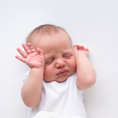 Newborn baby photography photo shoot. Sleeping baby. Photographer of photo shoot is Cheryl Catton , Woking.