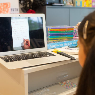 Little girl watching a slideshow on laptop